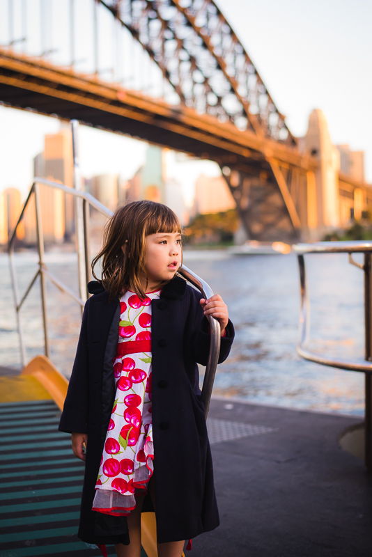 Four year old girl on with Sydney Harbour Bridge