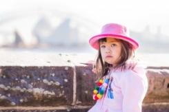 4 year old girl with Sydney Opera House in sunshine at Botanical Gardens