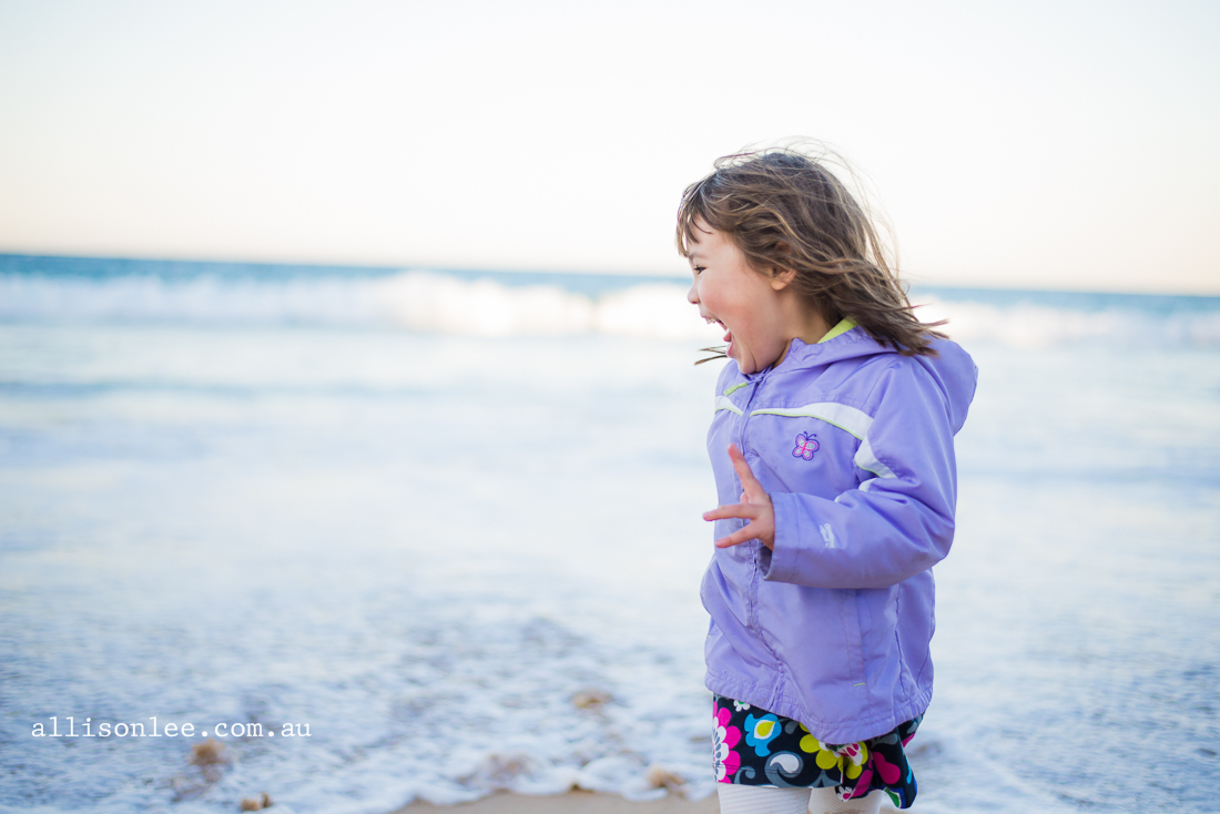 Four year old girl at the beach in winter