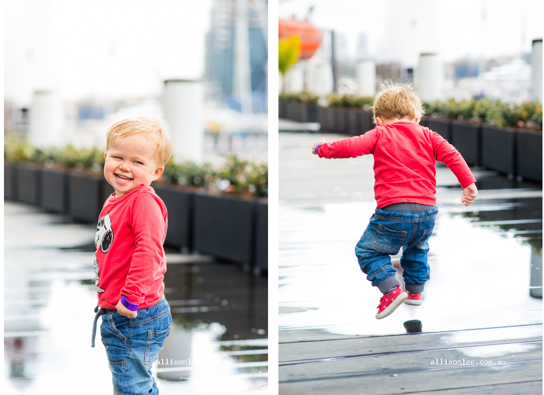 Cheeky two year old splashing in Darling Harbour