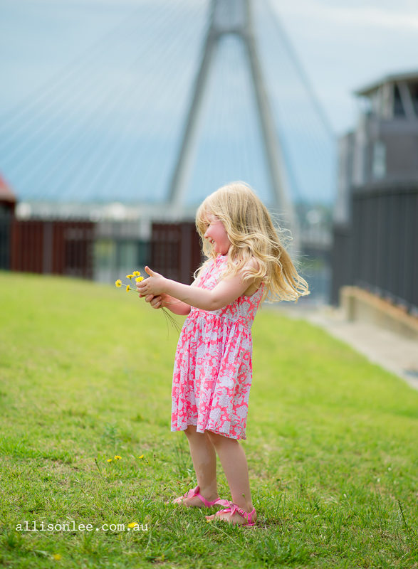 Four year old blonde girl picking flowers in Pyrmont