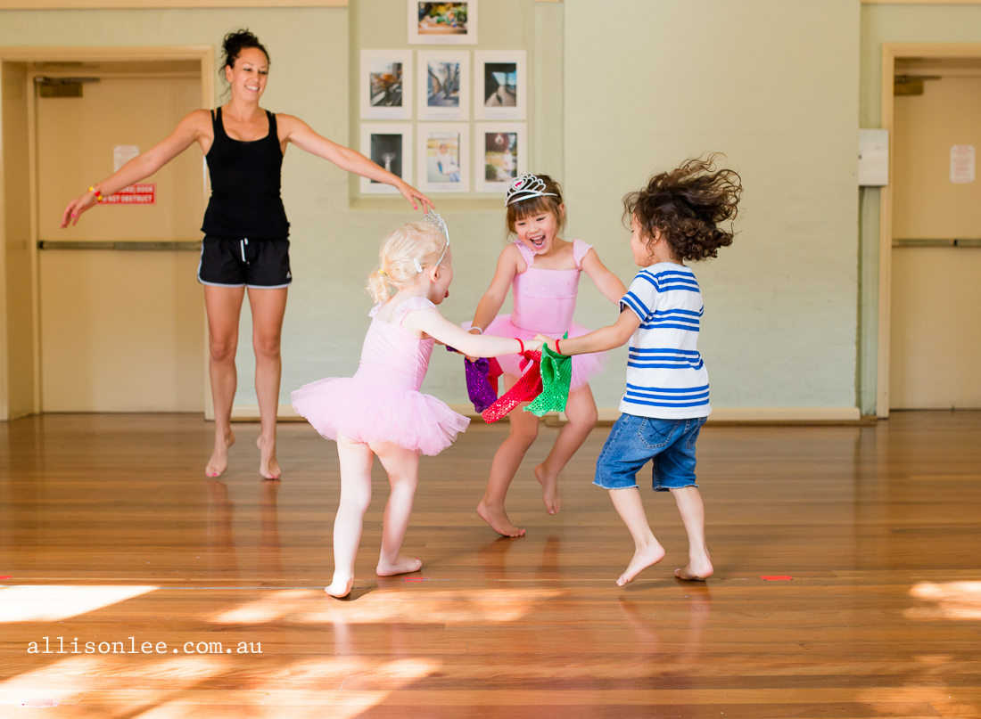 two girls and a boy dancing in class