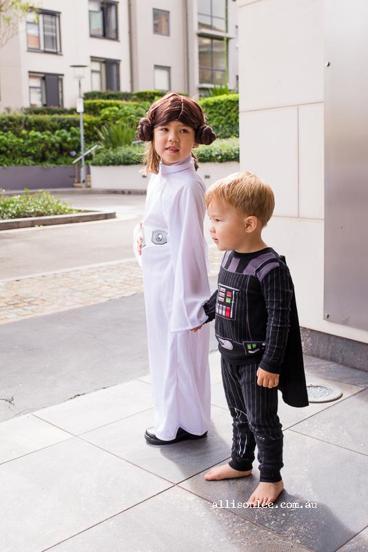 Boy and girl dresses as Princess Leia and Darth Vader