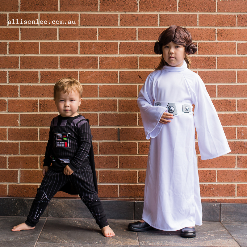 Boy and girl portraits dressed from star wars