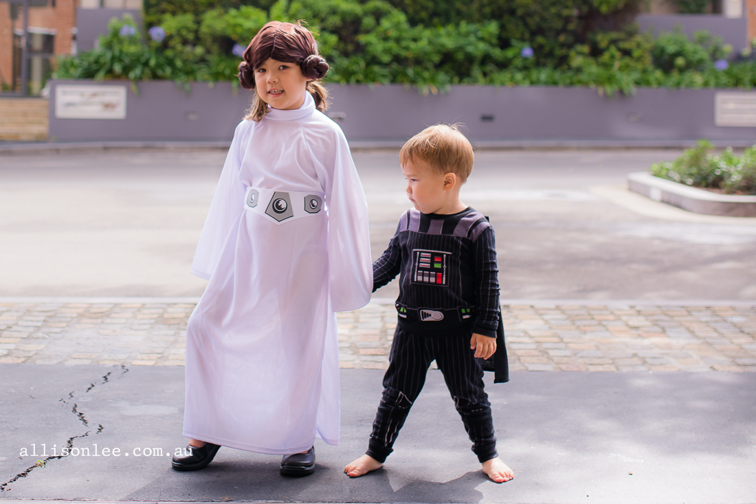 siblings playing dress up from star wars