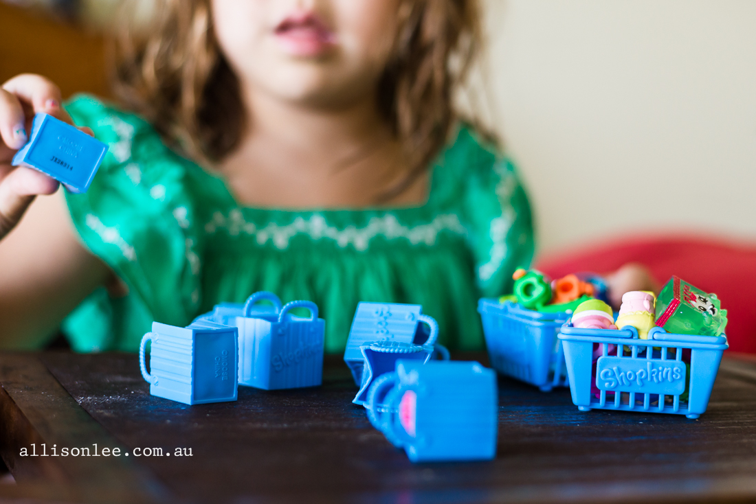 girl playing with shopkins