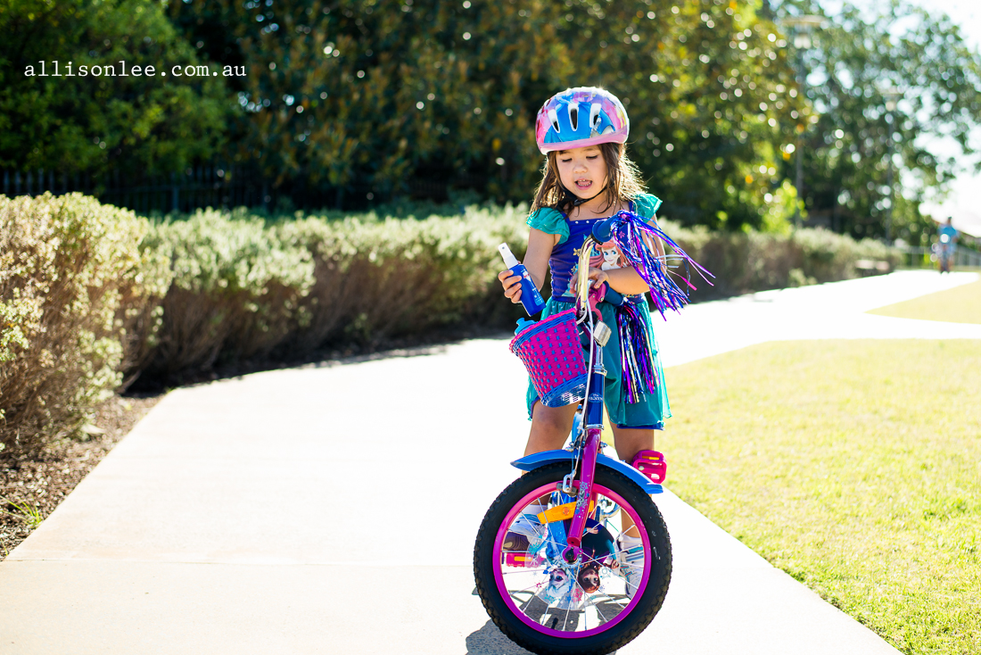 brown haired girl riding frozen bike