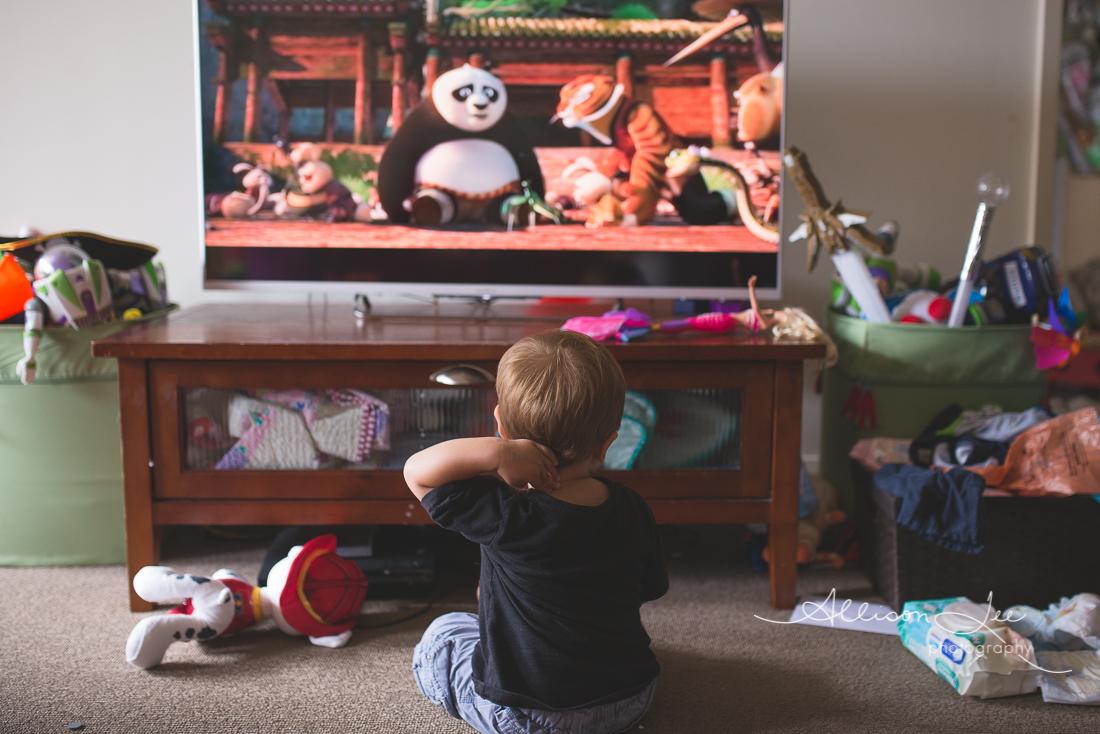 Boy watch Kung Fu panda