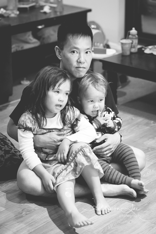 Dad watching TV with kids