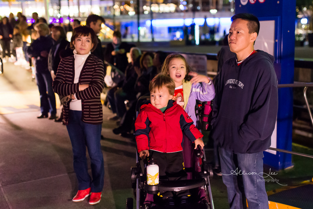 Family going to Vivid on the ferry