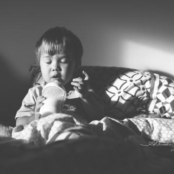 little boy resting drinking bottle