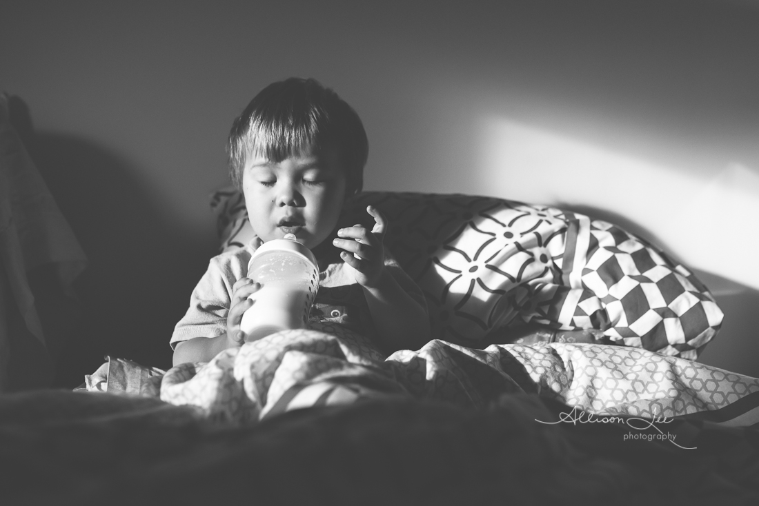 little boy resting drinking bottle