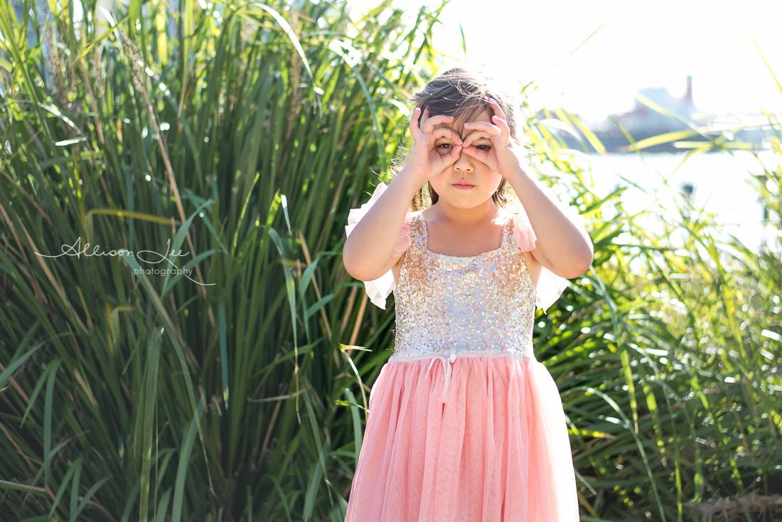 Six year old girl portrait in gold sun